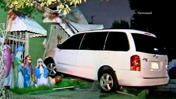 10 Fwy hit-run car slams into Mid-City home