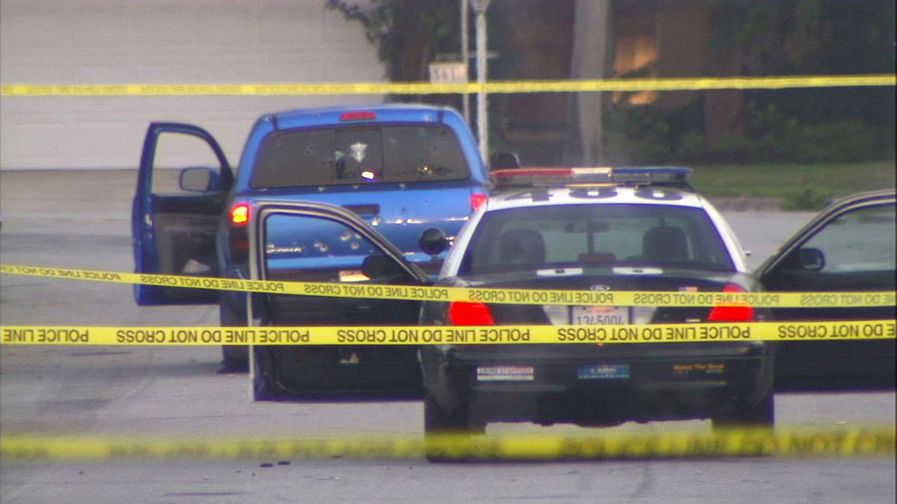 Two women were delivering newspapers on Feb. 7, 2013, when LAPD officers guarding the Torrance home of a target named in an online manifesto blasted at least 100 rounds at their pickup truck.