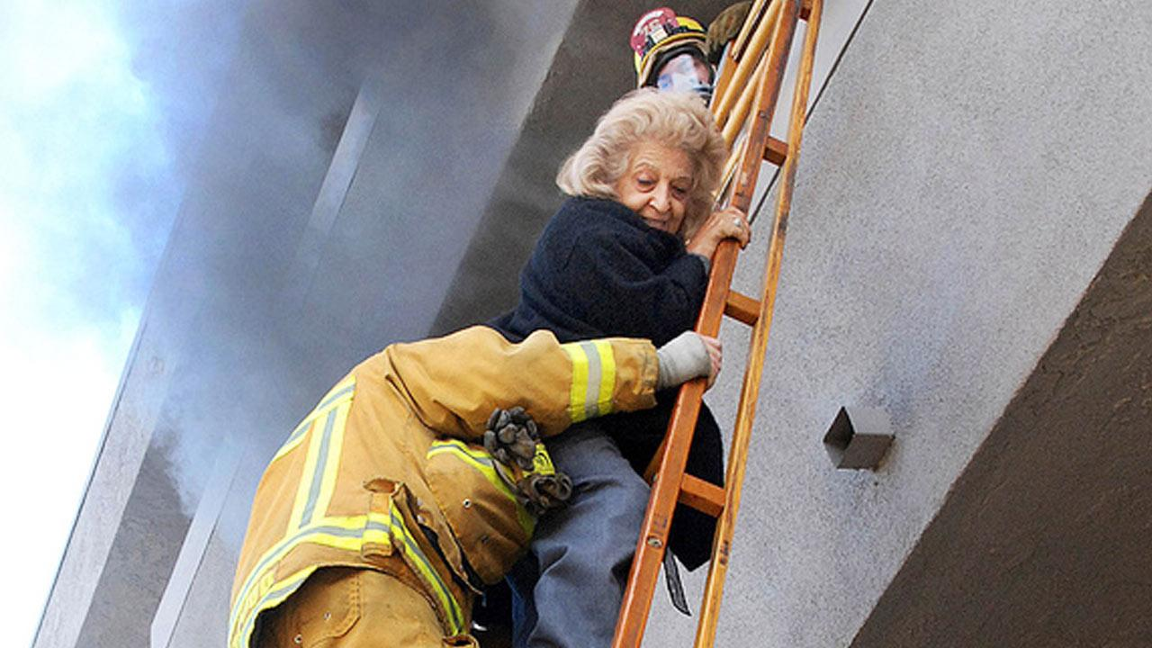 LAFD crews rescued two residents trapped on a balcony, while a third was taken to the hospital with non-life threatening injuries related to smoke exposure Wed., Feb. 13, 2013.
