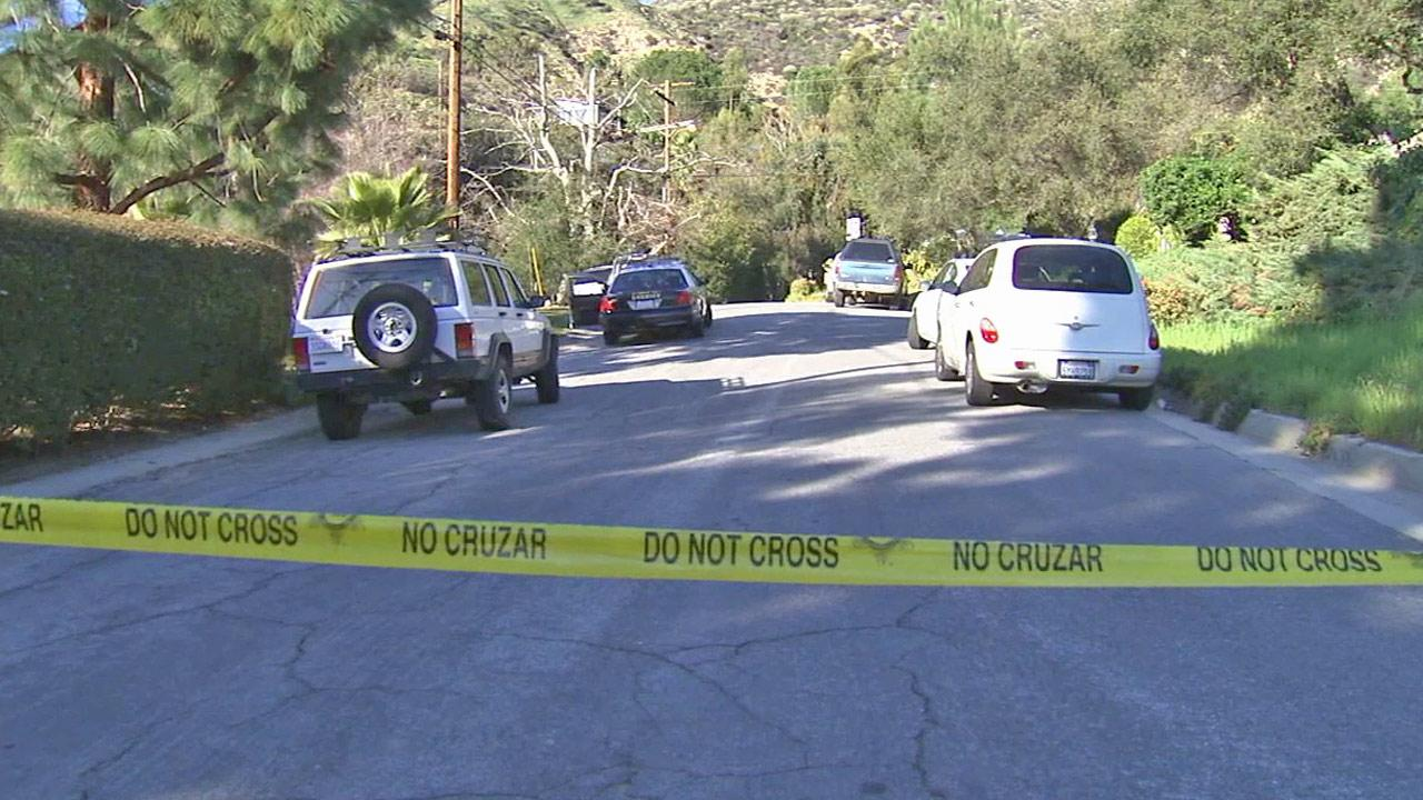 Crime tape ropes off the scene at an Altadena horse trail, where a passerby discovered a body on Saturday, Feb. 16, 2013.