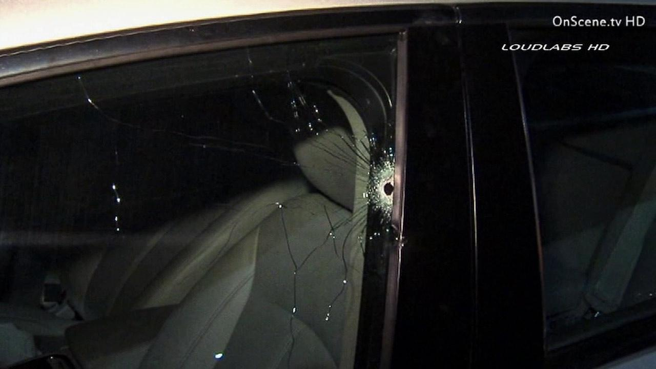 A woman was shot in the back after she fled away in her vehicle from an attempted carjacking at the intersection of Pico and Redondo boulevards in the Mid-Wilshire District of Los Angeles Sunday, Feb. 17, 2013.