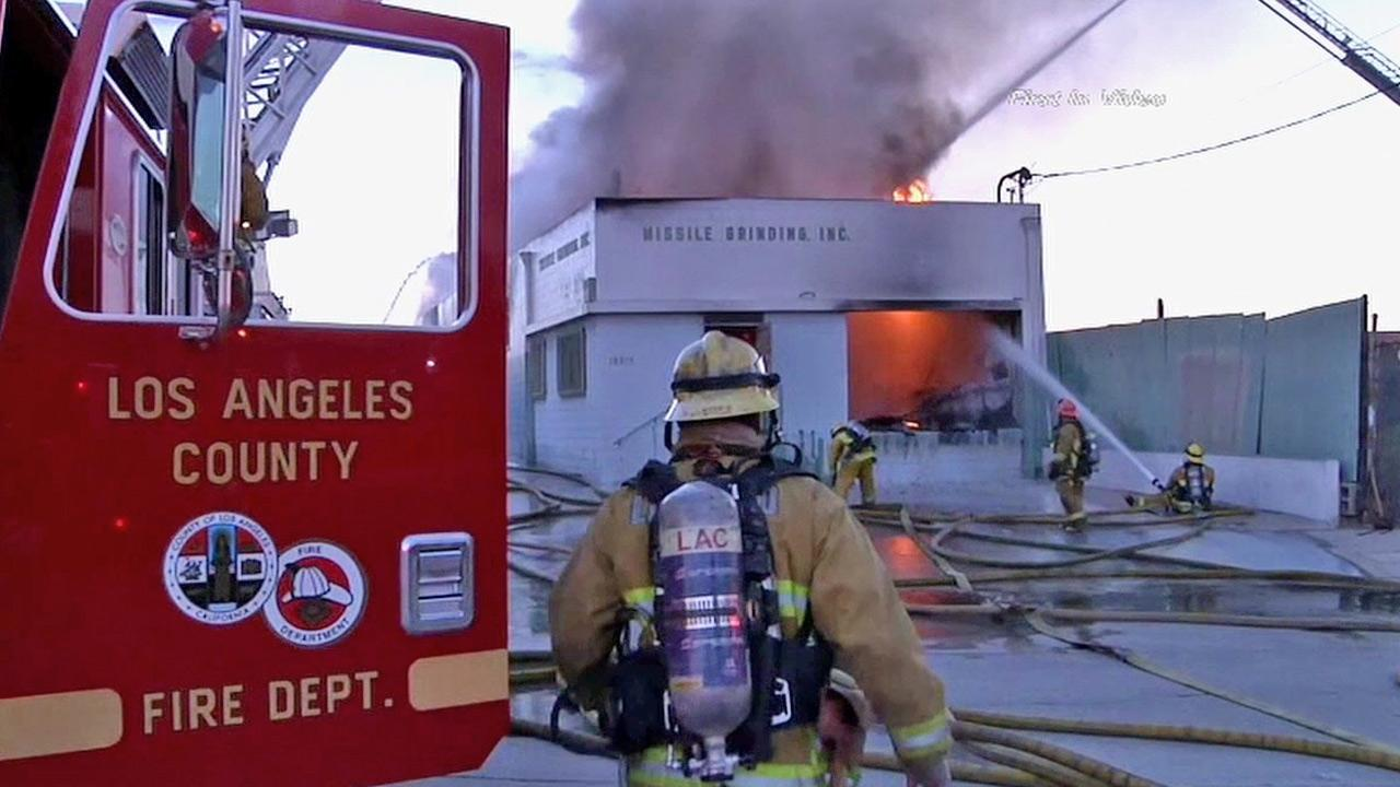 Firefighters are shown battling a blaze at a building in Carson on Saturday, March 2, 2013.