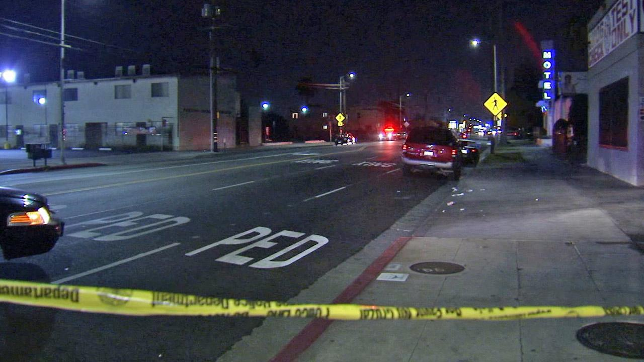 Crime tape ropes off the scene of a shooting near a bus stop in South Los Angeles on Saturday, March 2, 2013.
