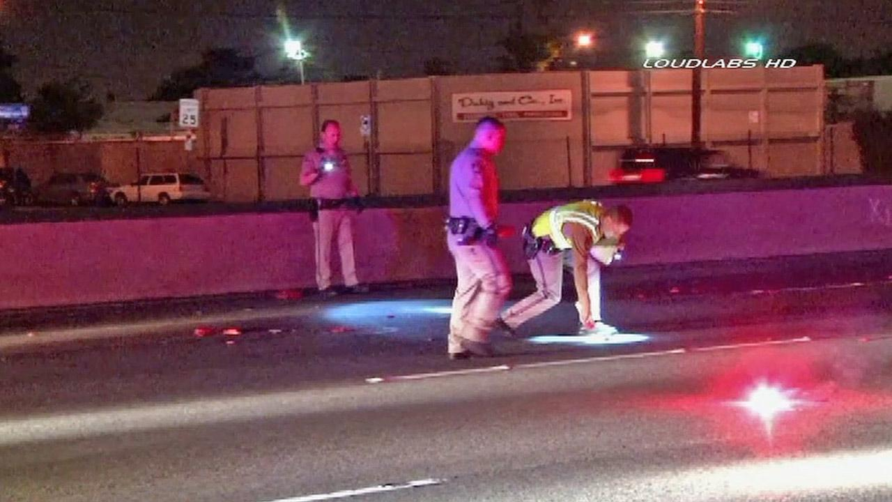 California Highway Patrol officers investigate the scene of fatality on the 5 Freeway in East Los Angeles on Sunday, March 3, 2013.