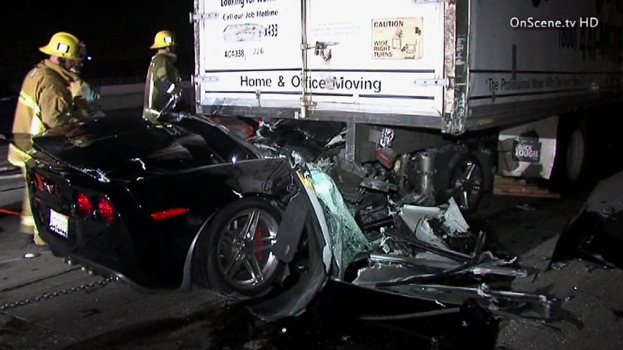 A driver was injured after the Corvette he was driving rear-ended and became stuck under a box truck on the southbound 405 Freeway in the Sepulveda Pass on Monday, March 4, 2013.