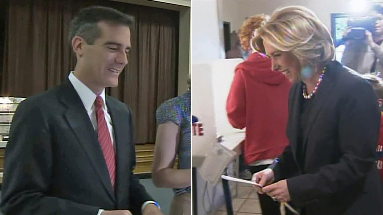 Councilman Eric Garcetti and City Controller Wendy Greuel are seen voting on Tuesday, March 5, 2013.