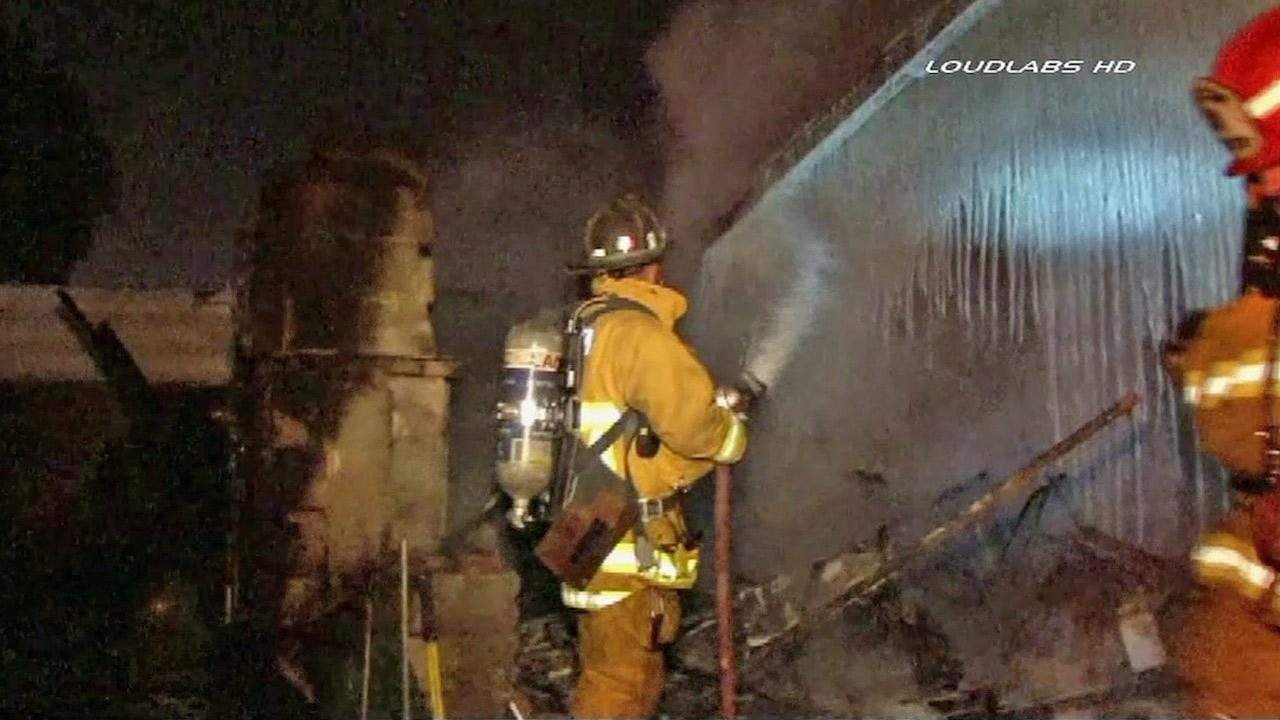 A firefighter douses flames at a Willowbrook house on Saturday, March 9, 2013.