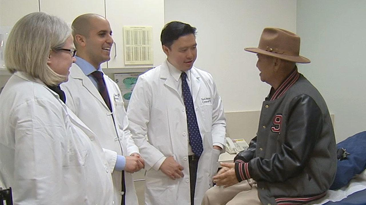 On Monday, March 18, 2013, Tobias Aldan (right), mayor of the Northern Mariana Islands in the Pacific Ocean, speaks with doctors at Keck Medical Center of USC, who are treating him for a rare, small cell cancer of the sinus.