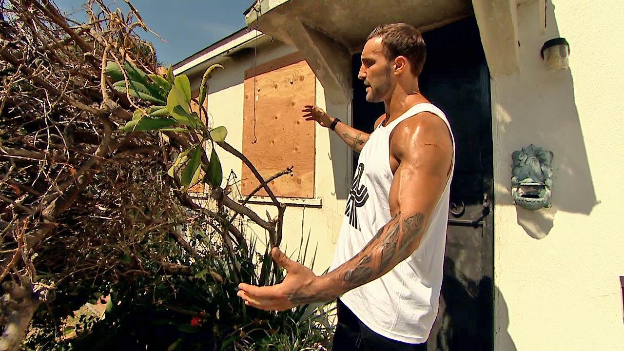 Former WWE superstar Chris The Masterpiece Masters is seen outside his mothers house after a neighbor allegedly set it ablaze on Tuesday, March 19, 2013. Masters saved his mother from the fire by breaking in a window with a tree.