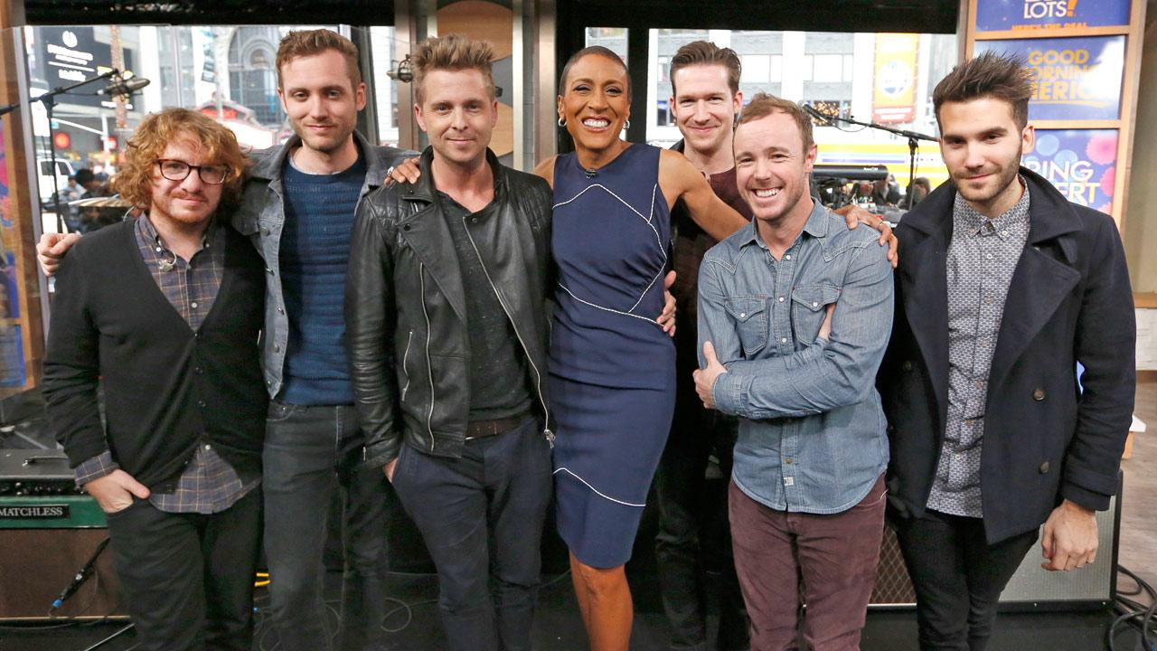 Robin Roberts poses with members of OneRepublic on Good Morning America on Tuesday, March 26, 2013.