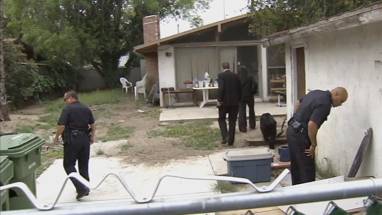 Los Angeles police on Monday, April 1, 2013, investigate a home in the 18200 block of Rayen Street in Northridge, where a suspect was taken into custody a day prior in connection with the kidnapping of a 10-year-old girl.