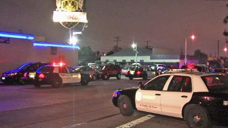 Patrol vehicles are shown outside Nicolas, a topless club in the 900 block of South Gerhard Avenue, on Friday, April 05, 2013.