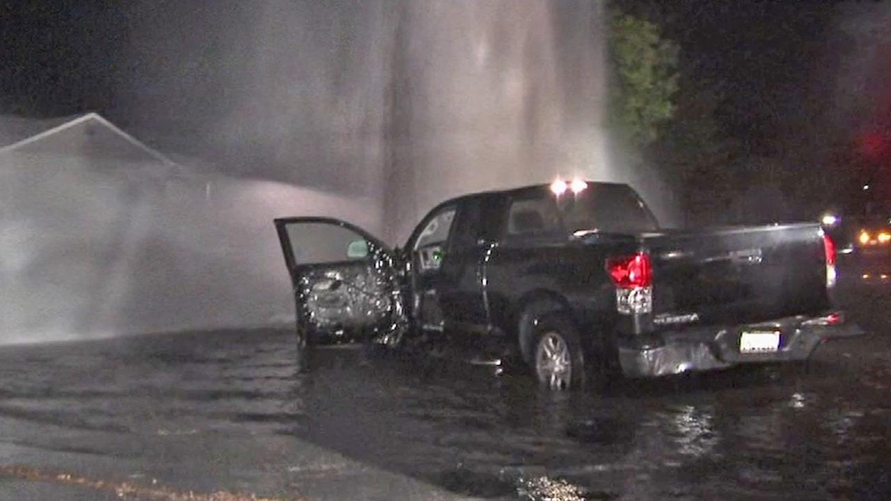 A truck slammed into a fire hydrant near Roscoe Boulevard and Gloria Avenue in North Hills and caused flooding on Friday, April 5, 2013.
