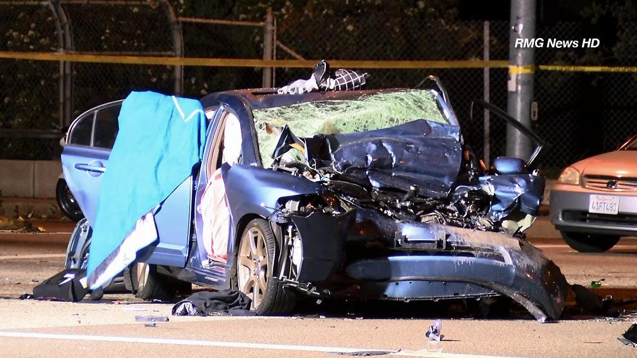 Wreckage from a four-car crash is seen in Azusa on Sunday, April 7, 2013. One person died and six others were injured in the crash.