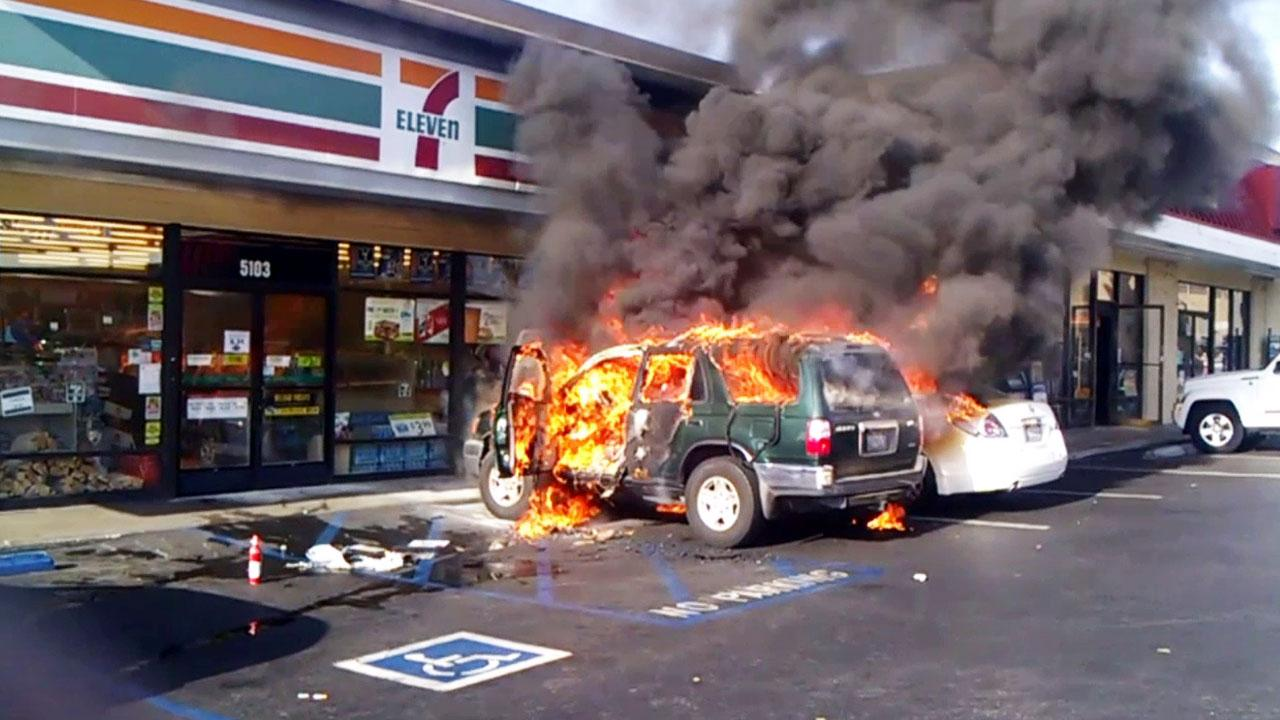A man was allegedly lit on fire in his vehicle outside a convenience store in Long Beach on Friday, April 12, 2013.
