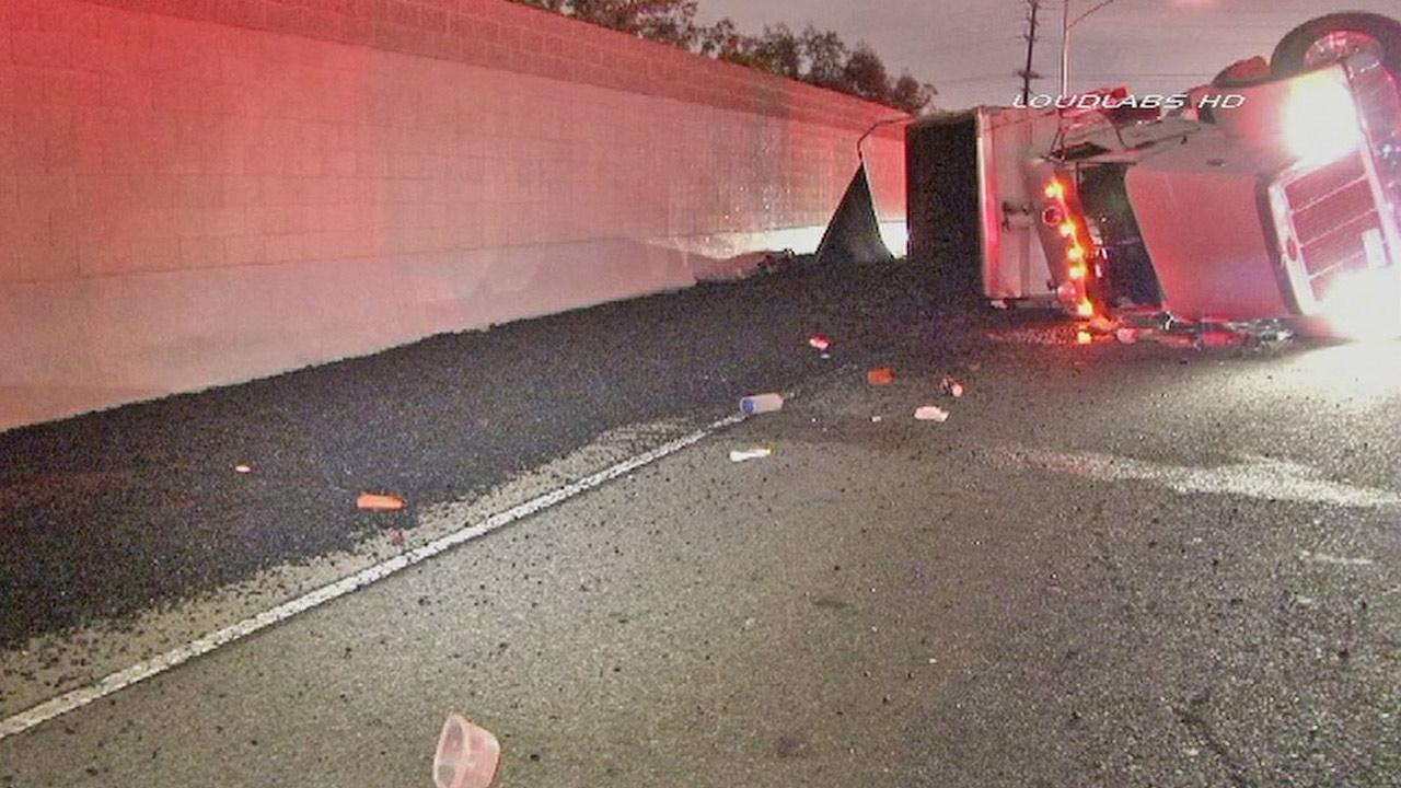 An overturned tanker spilled 20 tons of asphalt on to the 405 Freeway in Los Angeles on Sunday, April 14, 2013.