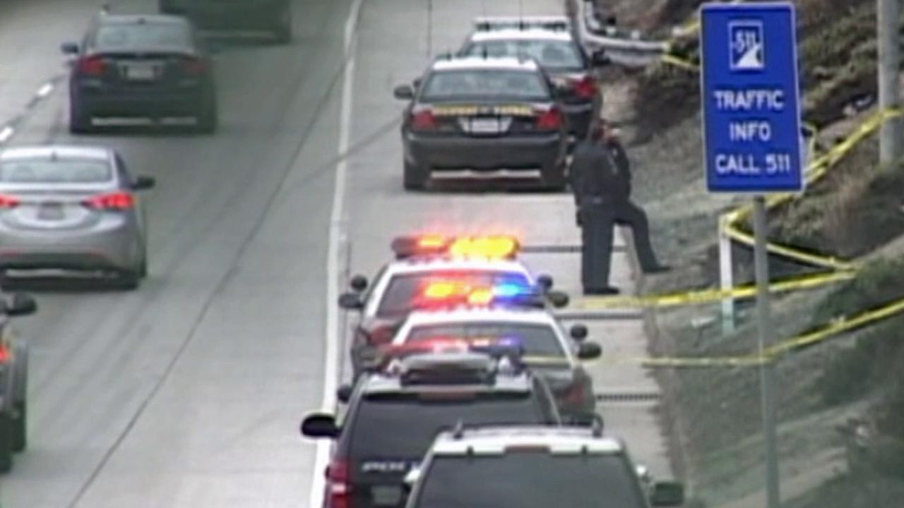 A body was discovered in a shallow grave near the Lakewood onramp on the westbound 105 Freeway on Sunday, April 14, 2013.