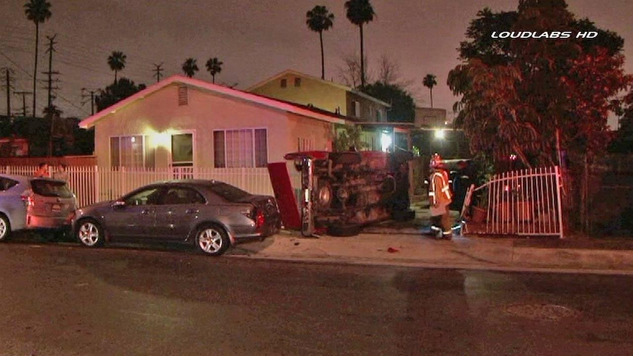 Authorities respond to the scene of a single-vehicle crash that sent a pick-up truck into a home in the 3500 block of Blanchard Street in the City Terrace area of East Los Angeles on Sunday, April 14, 2013.