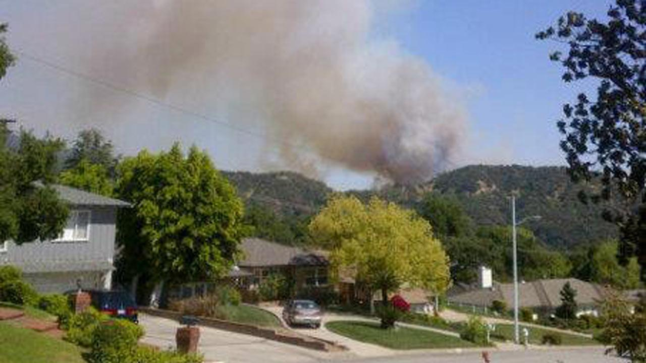 Firefighters responded to a brush fire in the area of Hillcrest Boulevard and Madison Avenue in Monrovia on Saturday, April 20, 2013. <span class=meta>(Anna Anna)</span>