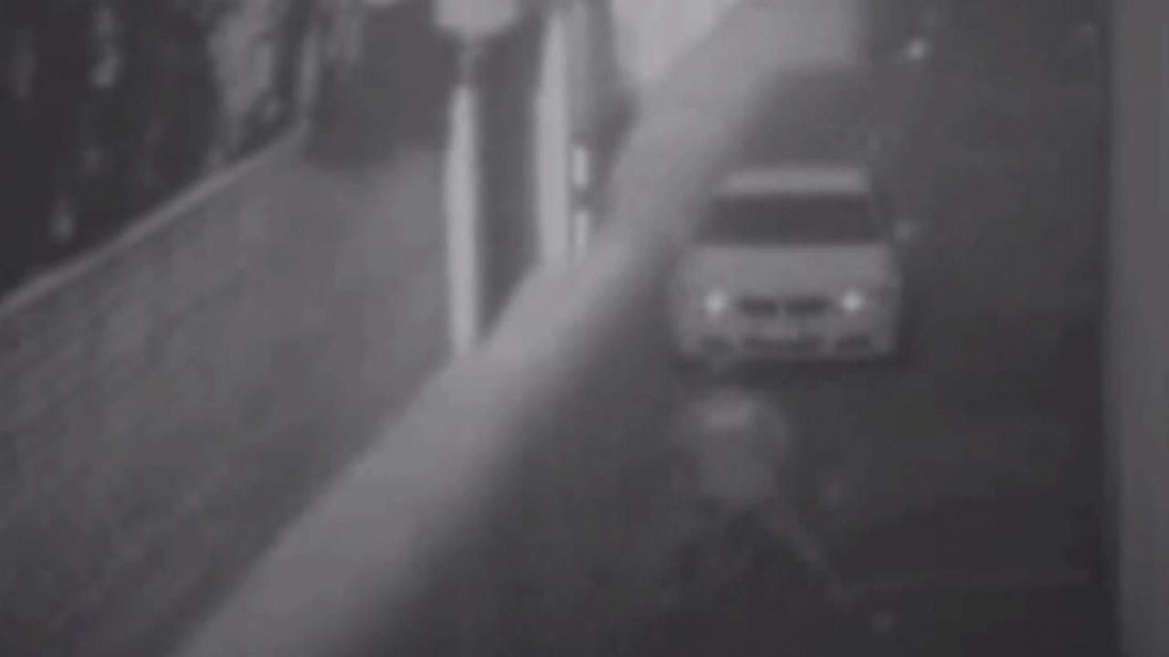 A driver in a BMW pinned a bicyclist to a trash bin in a violent case of road rage in Beverly Hills. The attack was caught on surveillance tape.