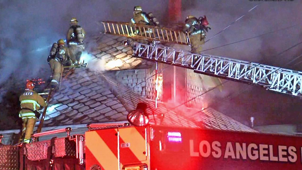 Firefighters battle a fire at a home in the 900 block of North Bonnie Brae Street in Echo Park on Wednesday, April 24, 2013.