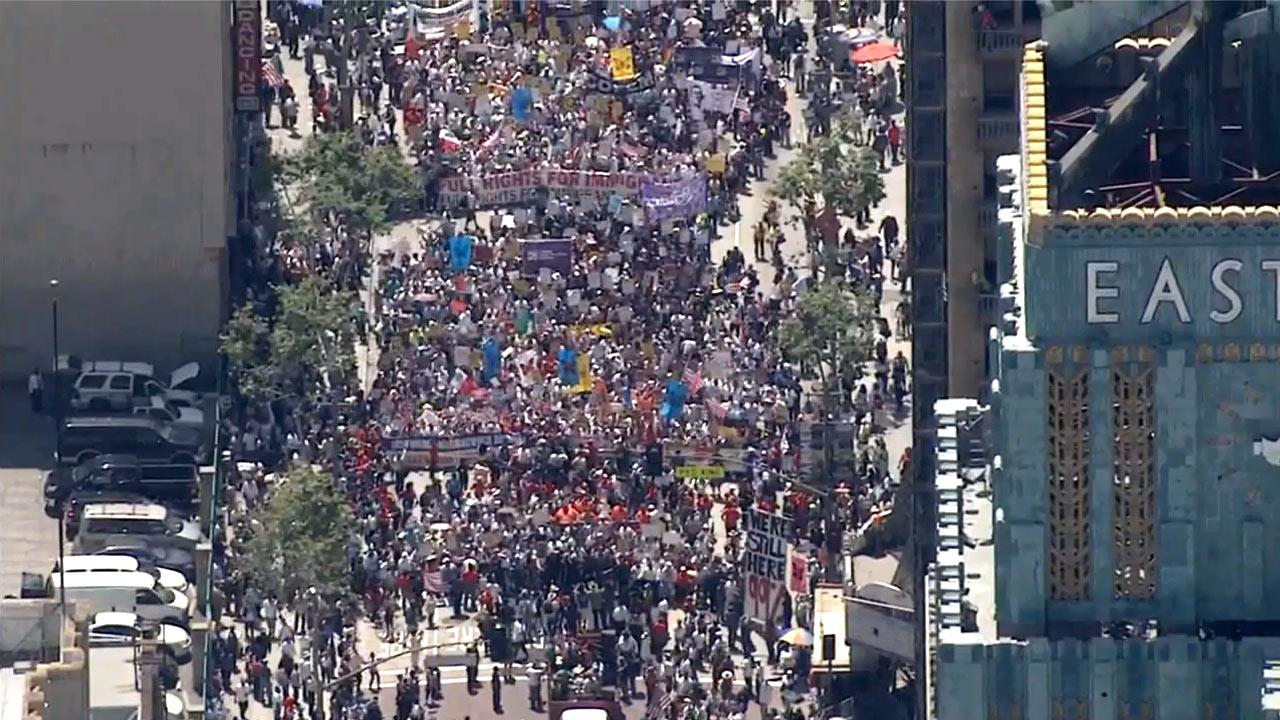 Thousands of protesters marched down Broadway in downtown Los Angeles on Wednesday, May 1, 2013 as part of May Day, a day of protests around the world over various issues.