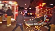 A man is wheeled out in a gurney following a shooting at a party in East Los Angeles on Saturday, May 25, 2013.