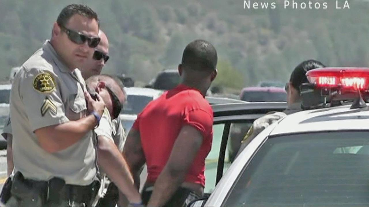 A suspected armed robber was arrested just 15 minutes after allegedly holding up a bank in Newhall on Saturday, May 25, 2013.