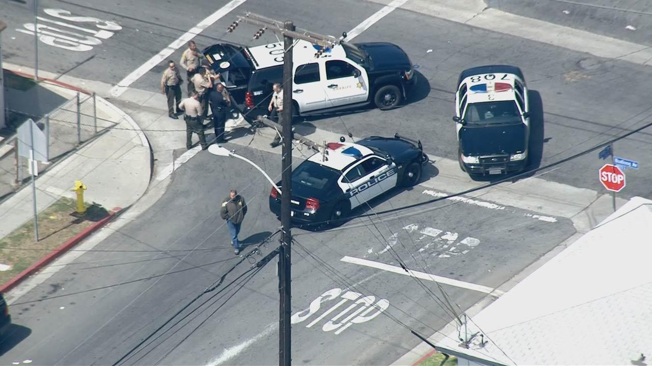 Los Angeles County Sheriff deputies were searching for at least two suspects who fled on foot after their vehicle crashed at Budlong Avenue and 119th Street during a pursuit on Tuesday, May 28, 2013.