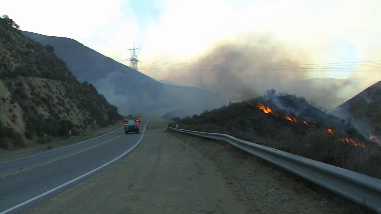 A brush fire burns in the Angeles National Forest, north of Santa Clarita, on Friday, May 31, 2013.