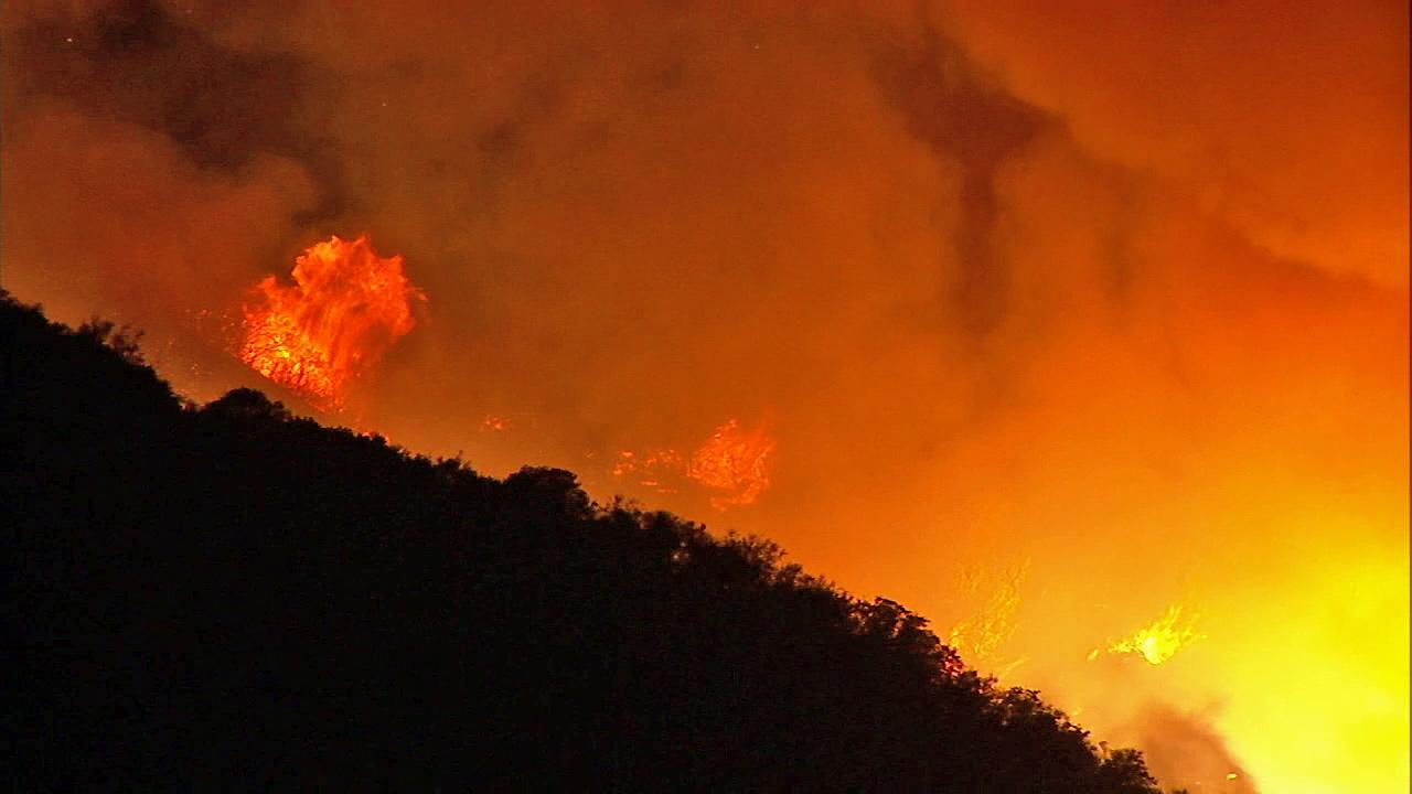 A brush fire burns in Santa Clarita in the Angeles National Forest on Thursday, May 30, 2013.