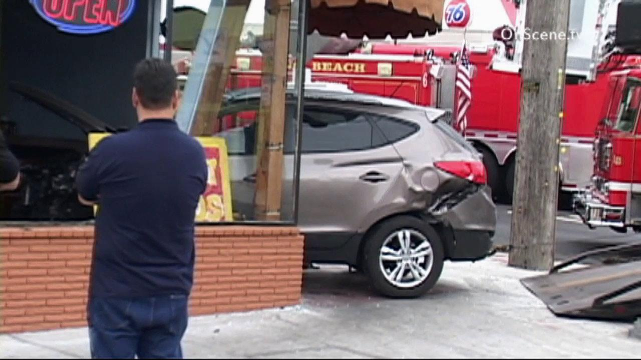 A car plowed into a restaurant in Long Beach on Sunday, June 2, 2013.