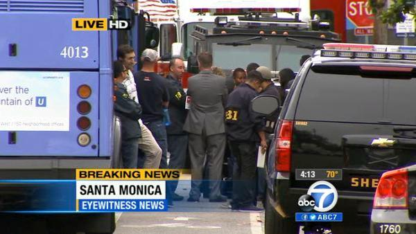 The FBI gathers at the scene of a shooting spree that ended at Santa Monica College on Friday, June 7, 2013.