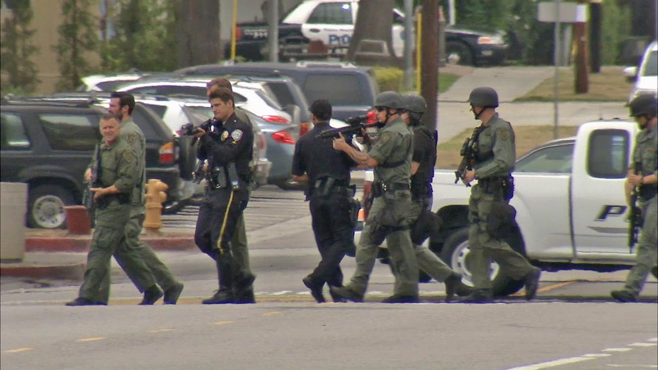 Law enforcement officers are shown in Santa Monica following the fatal shooting rampage on Friday, June 7, 2013.