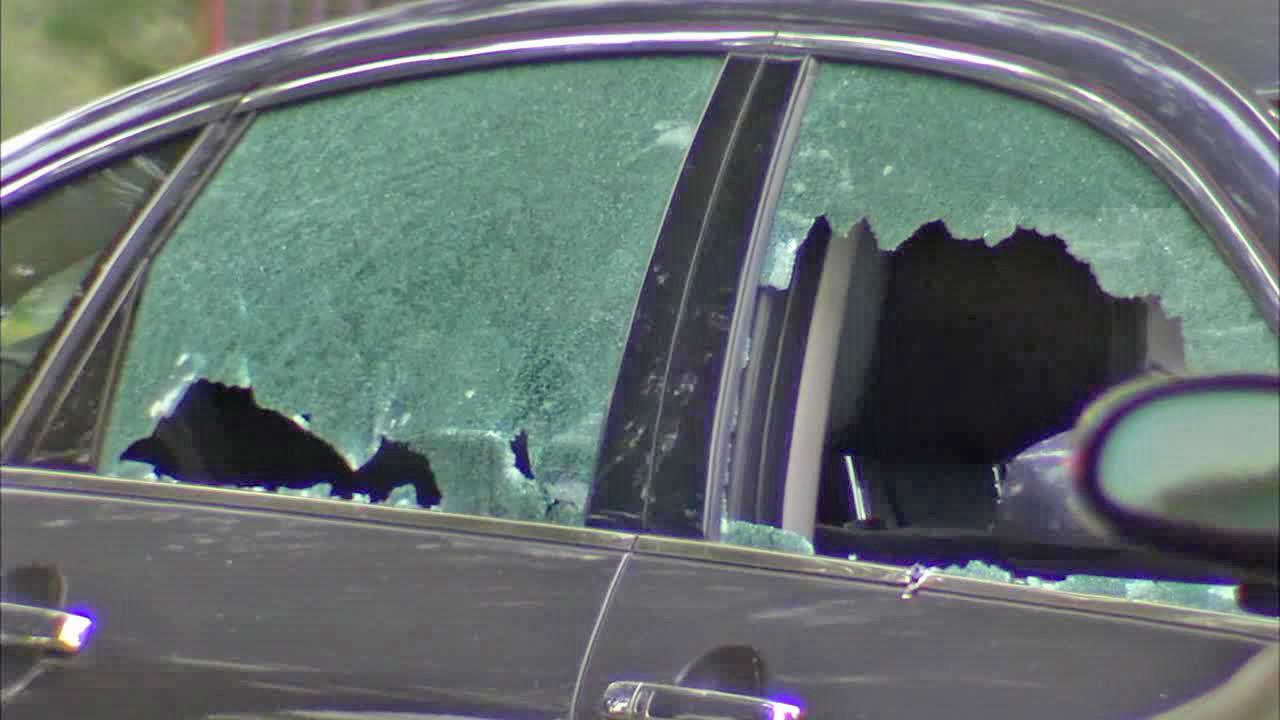 A cars windows are shattered after a gunman opened fire in Santa Monica Friday, June 7, 2013.