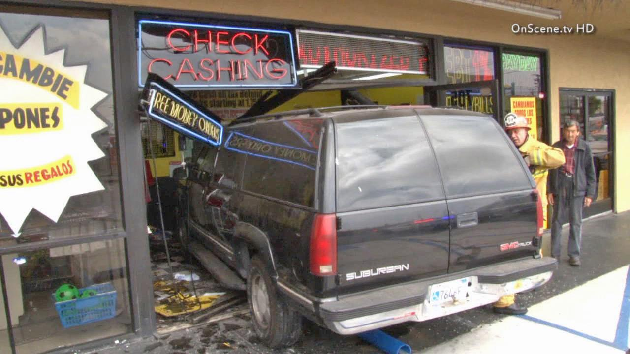 An SUV is seen after the driver crashed into a Western Union store in East Los Angeles on Saturday, June 15, 2013.