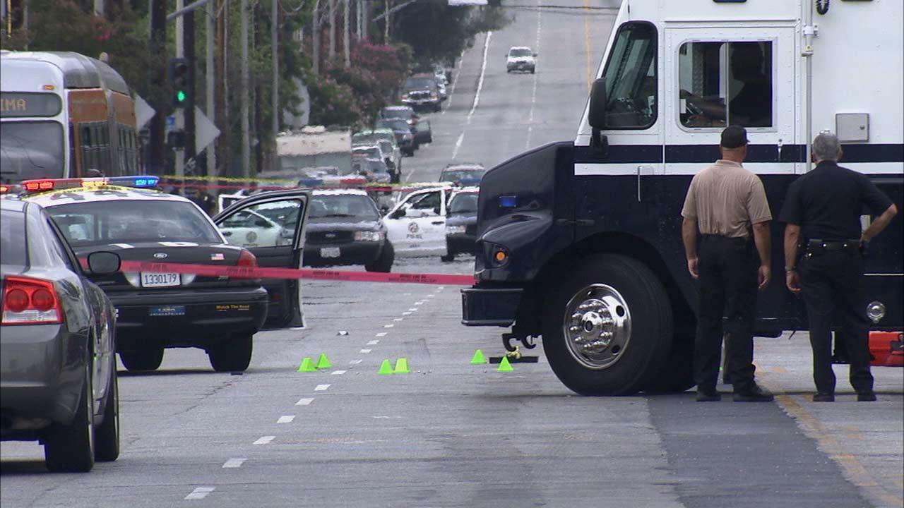 An alleged armed and dangerous suspect was shot and killed by Los Angeles police officers on the 1200 block of Van Nuys Boulevard in Pacoima Sunday, June 30, 2013.