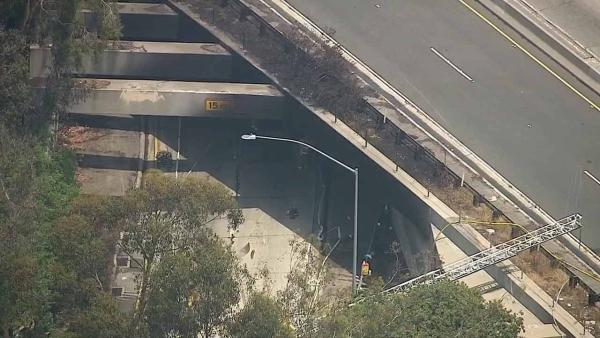 A tanker truck carrying 7,500 gallons of fuel caught fire in a tunnel underneath the 5 Freeway and 2 Freeway interchange in Los Angeles on Saturday, July 13,
