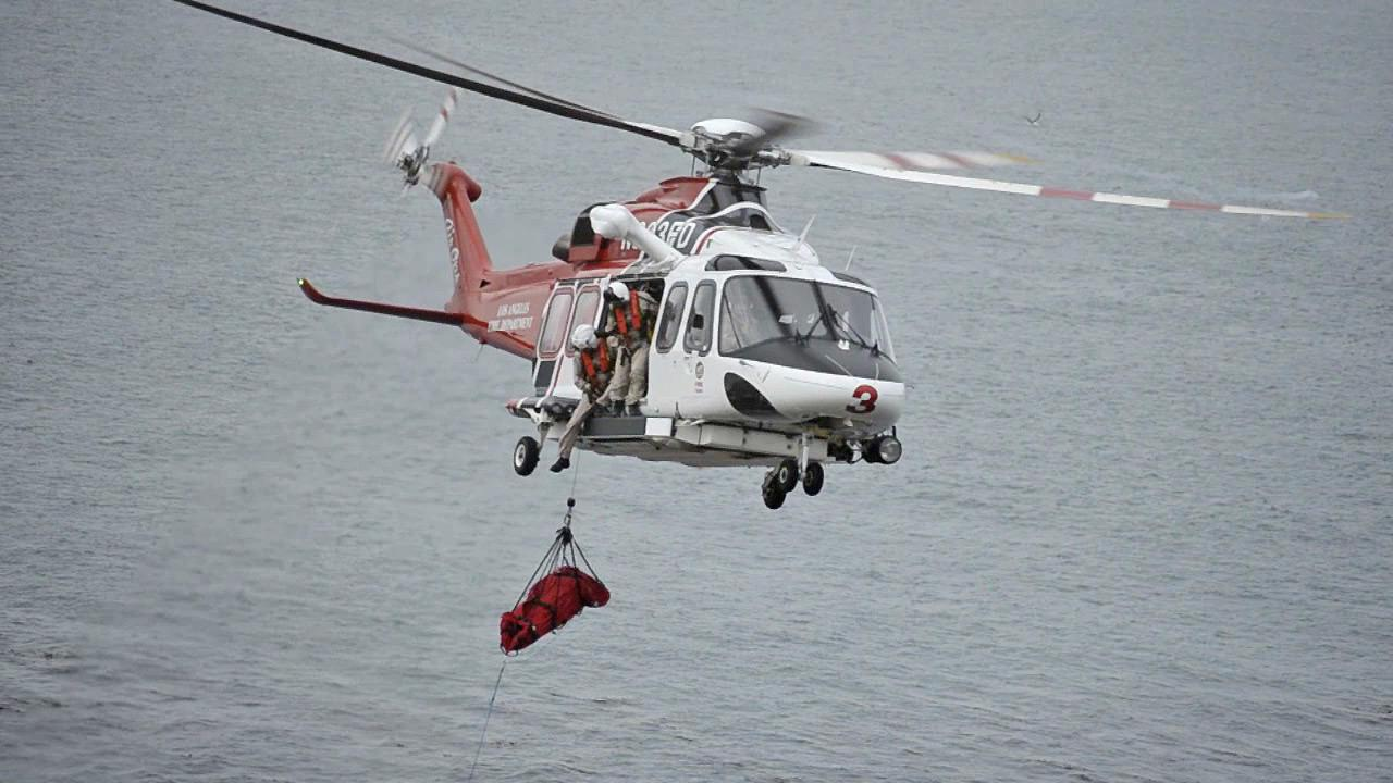 A girl who fell from a cliff in San Pedro is airlifted from the scene Saturday, July 20, 2013.