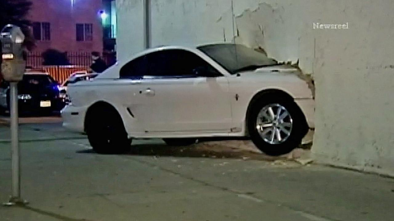 A car slammed into a martial arts school in Van Nuys, crashing straight through the wall of the building on Tuesday, July 23, 2013.