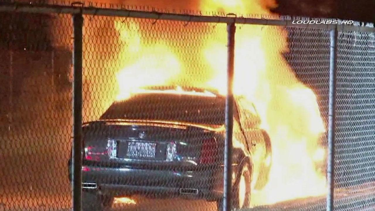 A car caught on fire in south Los Angeles on Friday, July 26, 2013.