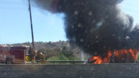 A bus burst into flames on the southbound 101 Freeway between Calabasas and Woodland Hills Saturday, July 27, 2013.