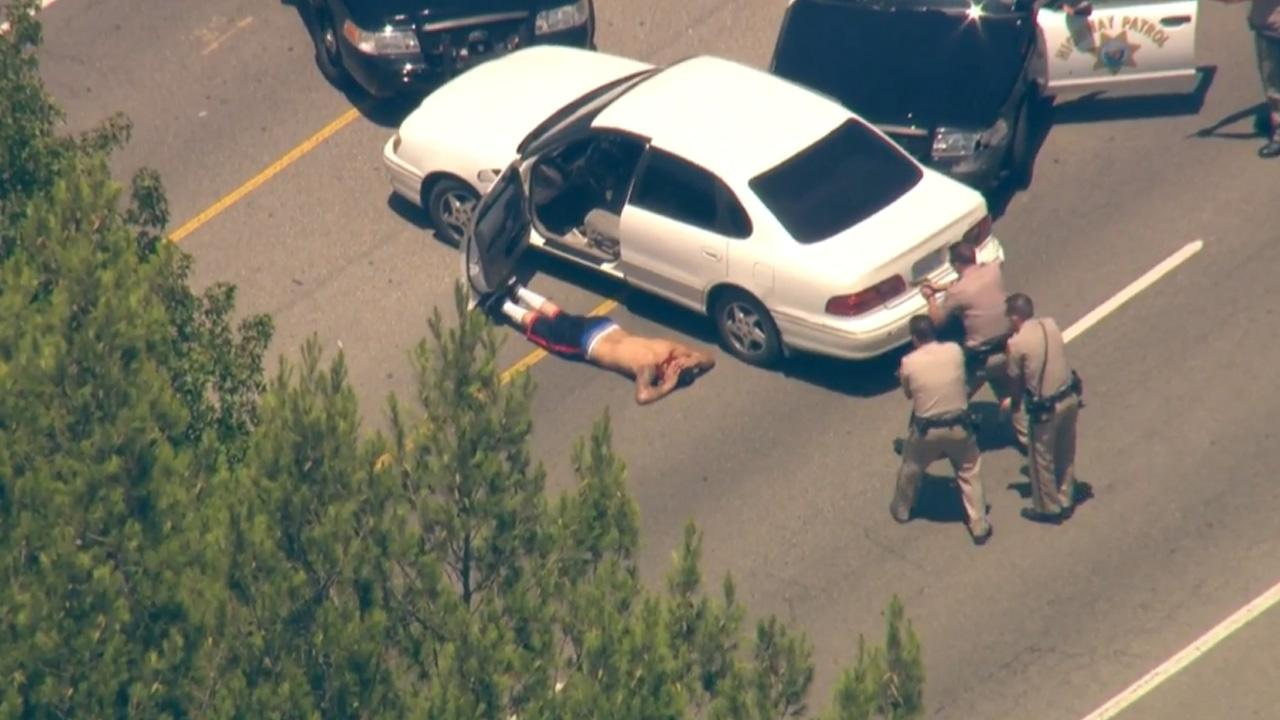 California Highway Patrol officers take a suspect into custody following a high-speed chase on the 118 Freeway on Wednesday, July 31, 2013.