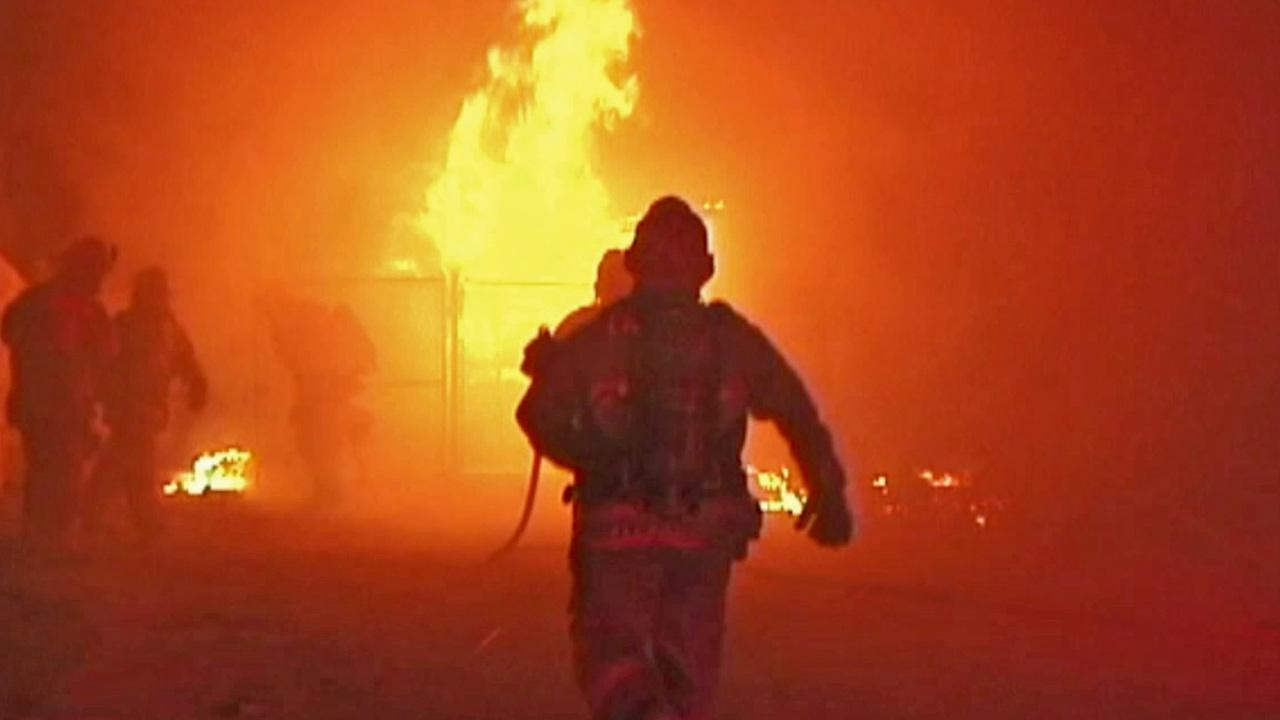 Firefighters battle a house fire in the 100 block of West Newgrove Street in Lancaster on Saturday, Aug. 3, 2013.