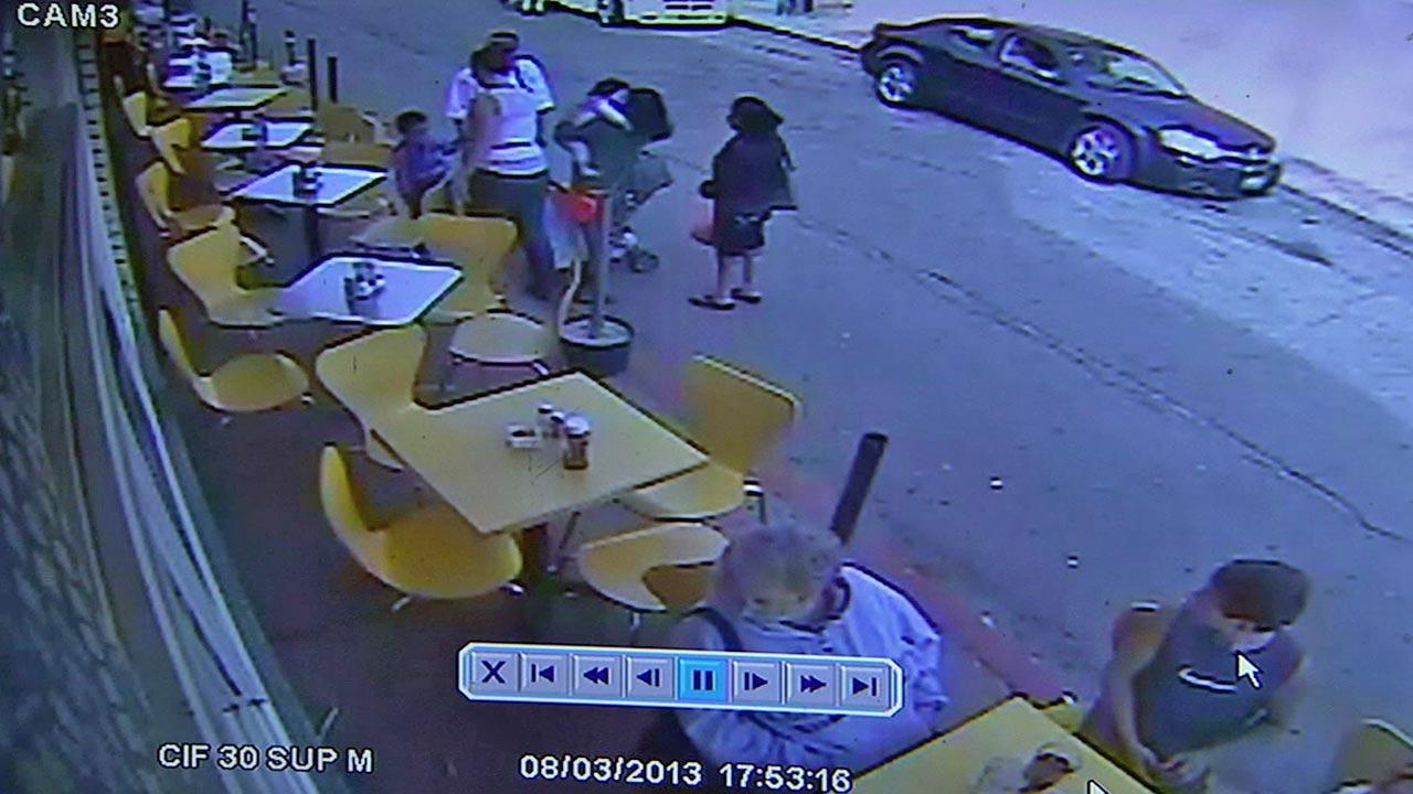 The car involved in the deadly hit-and-run crash that killed one person and injured 11 others on the Venice Beach boardwalk is shown before the incident in a surveillance still image on Saturday, Aug. 3, 2013.Candle Cafe & Grill