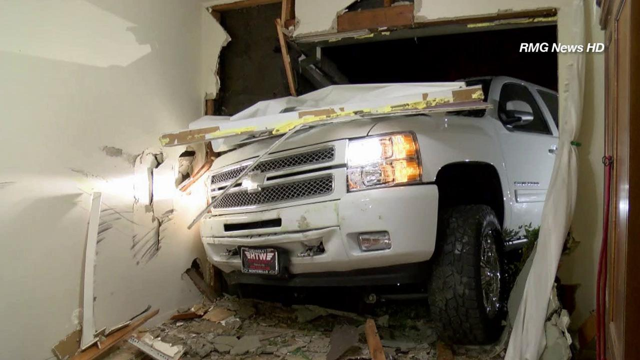 A truck slammed into a house on the 1000 block of Montezuma Way in West Covina on Tuesday, Aug. 13, 2013.