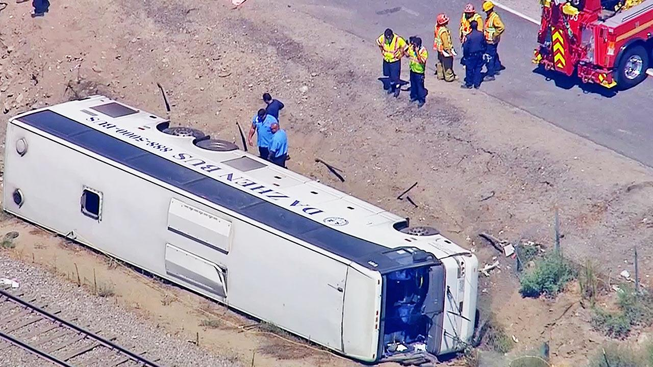 A tour bus with a sign that reads, Da Zhen Bus, overturned while traveling on the eastbound 210 Freeway in Irwindale on Thursday,  Aug. 22, 2013. Approximately 50 people were injured in the crash.