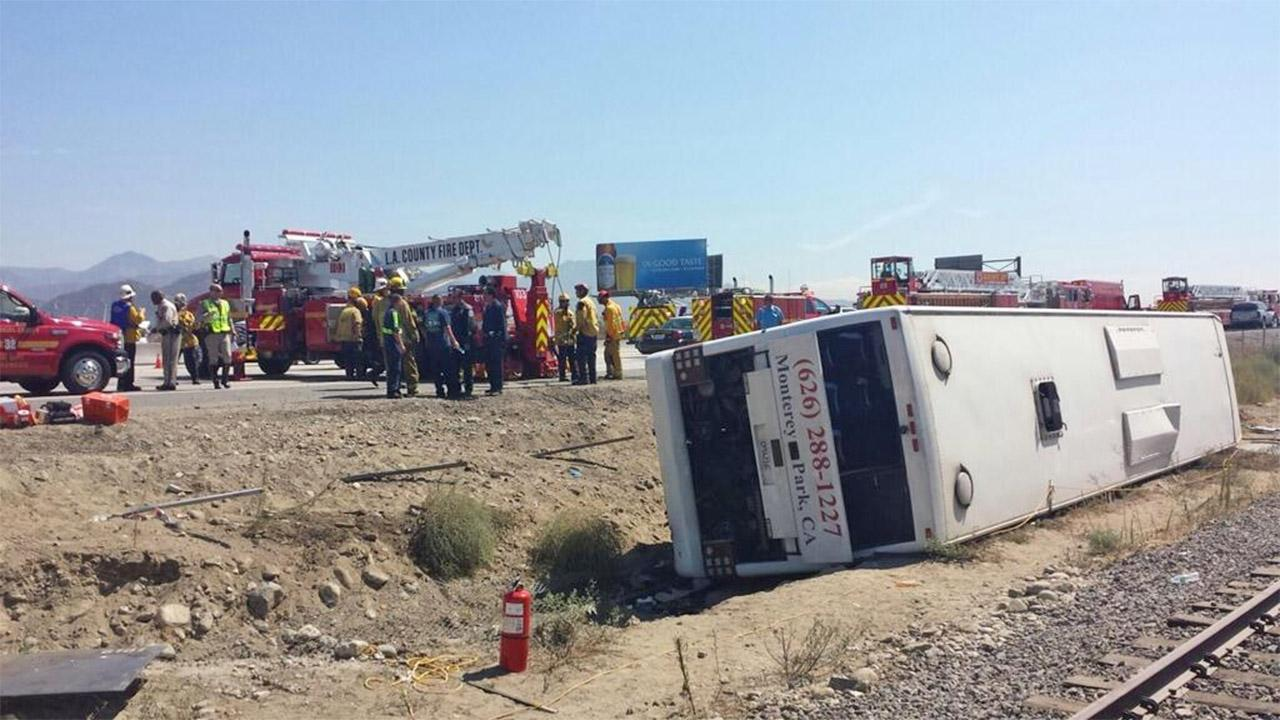 A tour bus with a sign that reads, Da Zhen Bus, overturned while traveling on the eastbound 210 Freeway in Irwindale on Thursday,  Aug. 22, 2013. Approximately 50 people were injured in the crash. <span class=meta>(Courtesy of Troy Case)</span>