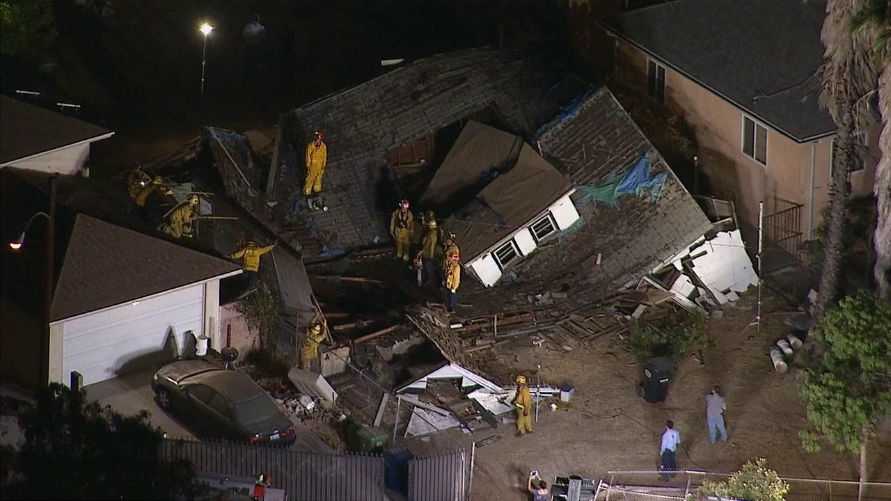 A house on the 500 block of South Humphreys Avenue in East Los Angeles collapsed on Friday, Aug. 30, 2013.