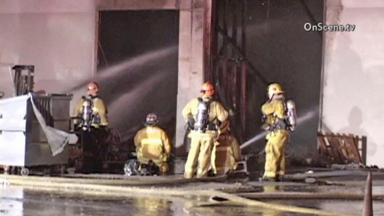Firefighters knock down a fire at a mechanic shop on the 2600 block of Pacific Drive in unincorporated Whittier on Monday, Sept. 2, 2013.